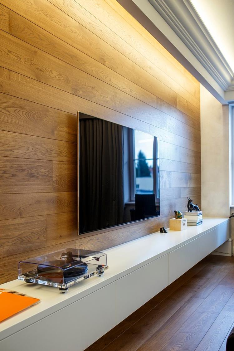 tv on a wood paneling wall