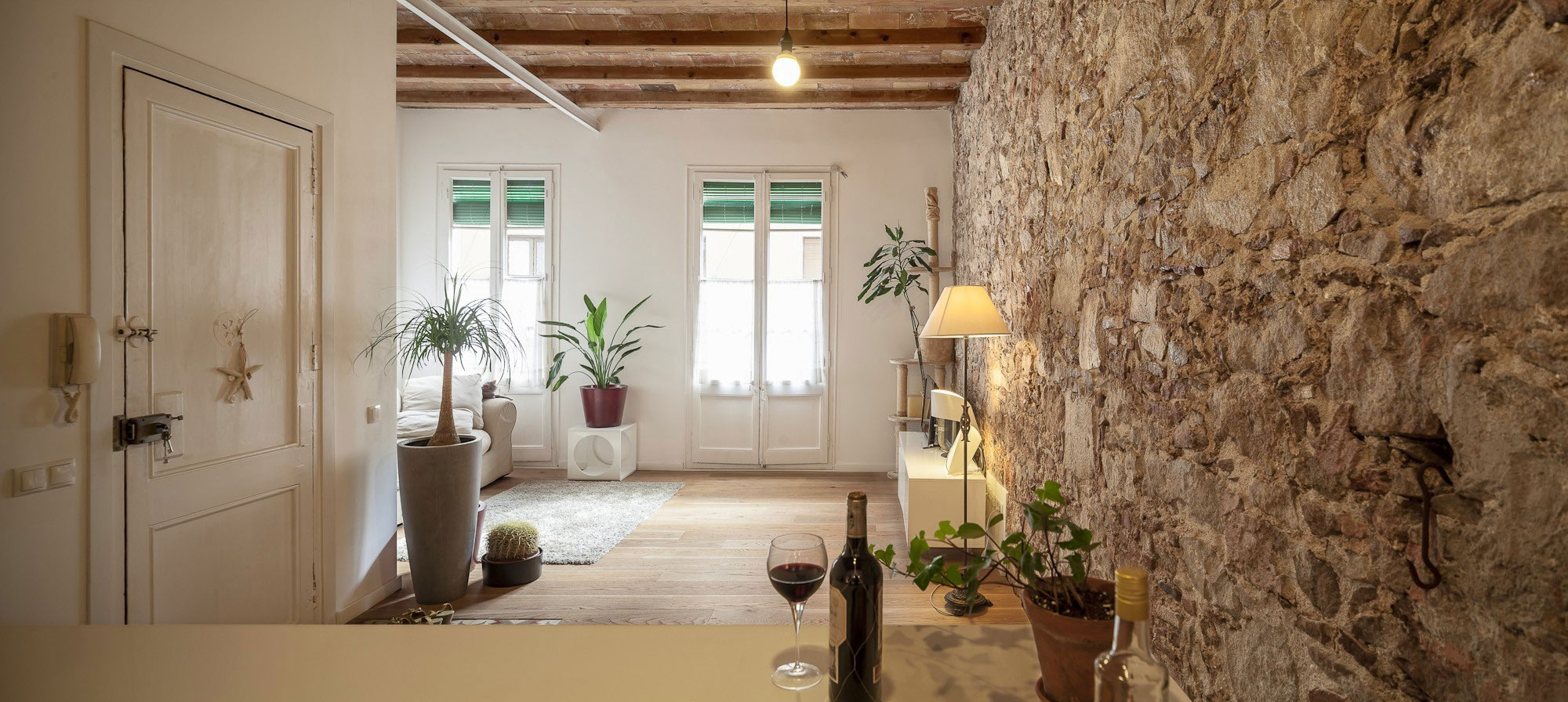Renovation Apartment in Les Corts living room windows
