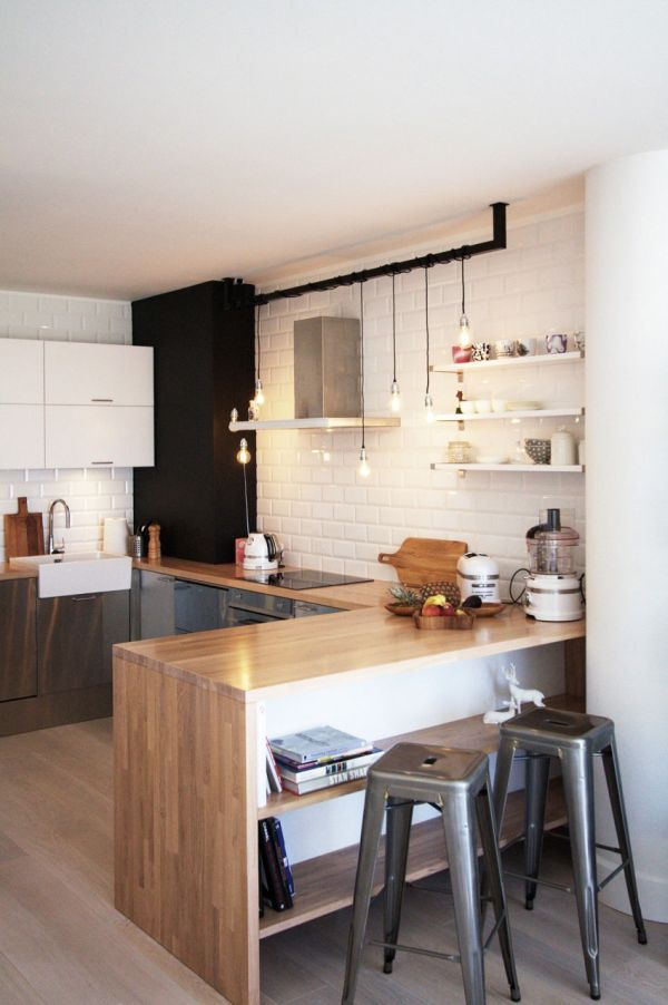 Scandinavian in Warsaw subway tiles cords lighting